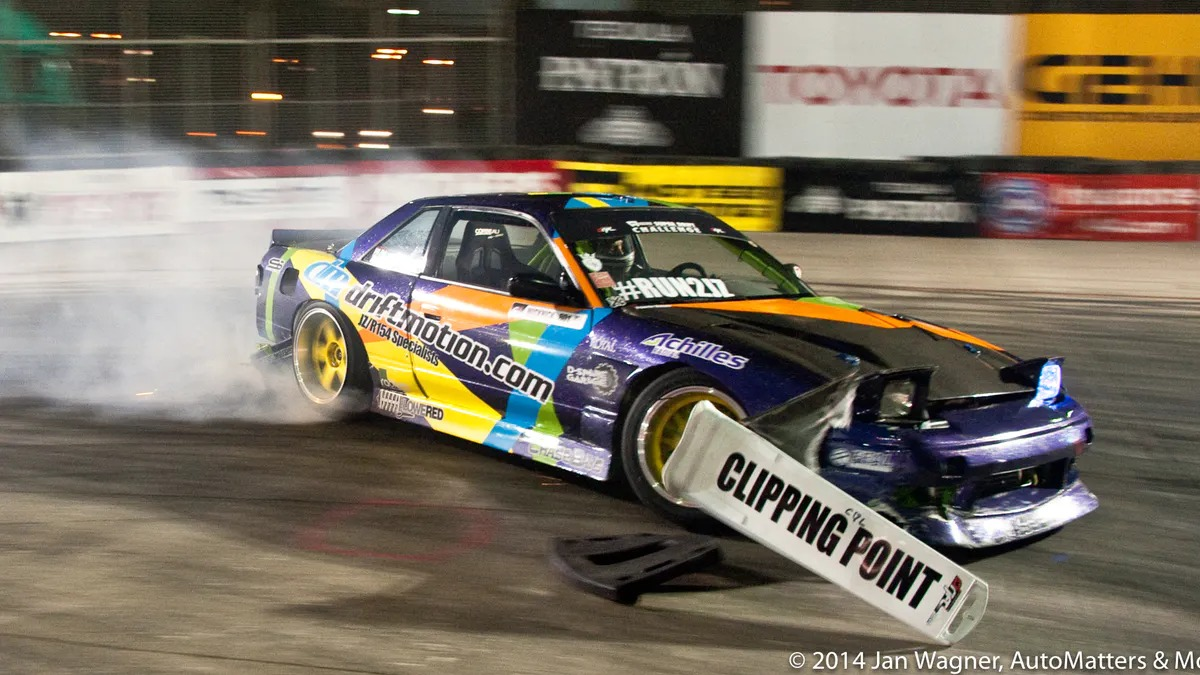Clipping the clipping point: drifting at night at the 2014 Toyota Grand Prix of Long Beach (California).