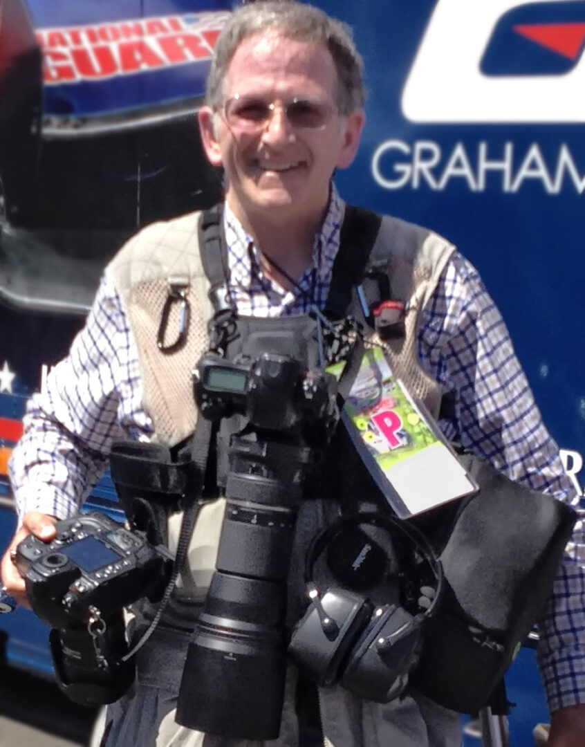 20140831 CU Jan wearing Cotton Carrier 2-Camera Vest System with lens pouch while covering INDYCAR race at Auto Club Speedway-IMG_3850-4in tall x 300dpi