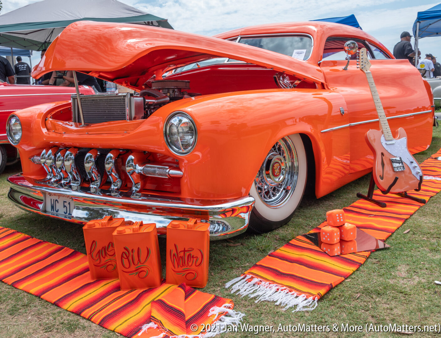 """Very orange lowrider at the 2021 """"Day At The Bay"""" custom car & bike show in San Diego"""